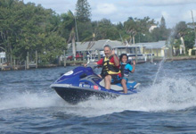 people riding jet skis