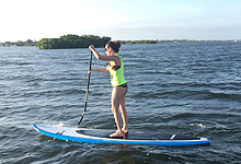 woman riding a paddle board